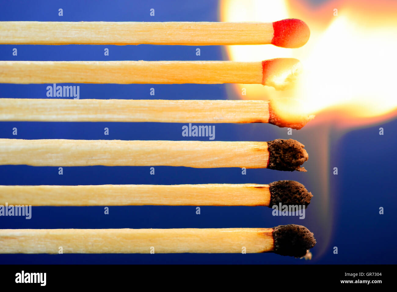Burning Matches, Domino Effect - Stock Image