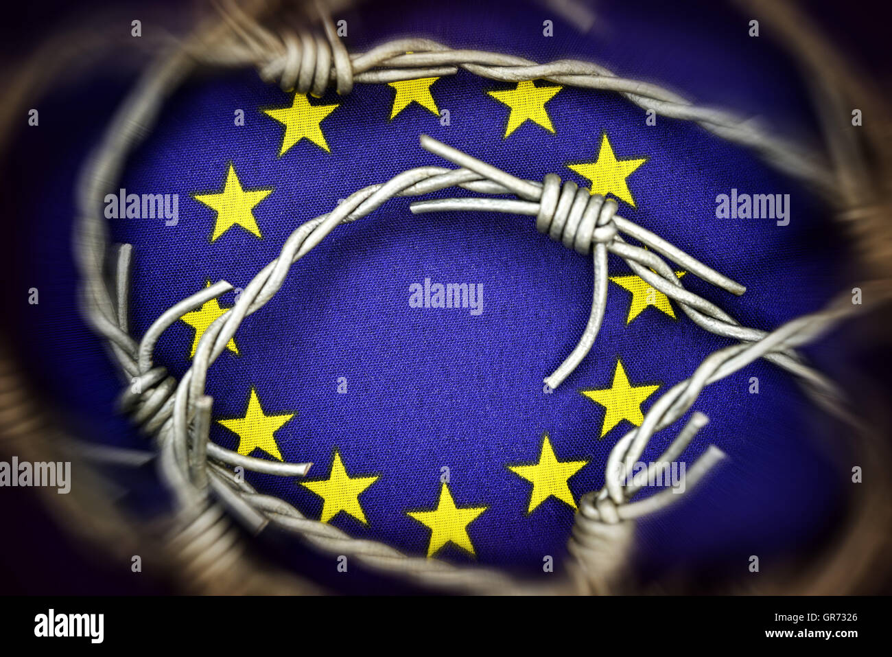 Flag Of The Eu And Barbed Wire, Flow Of Refugees - Stock Image