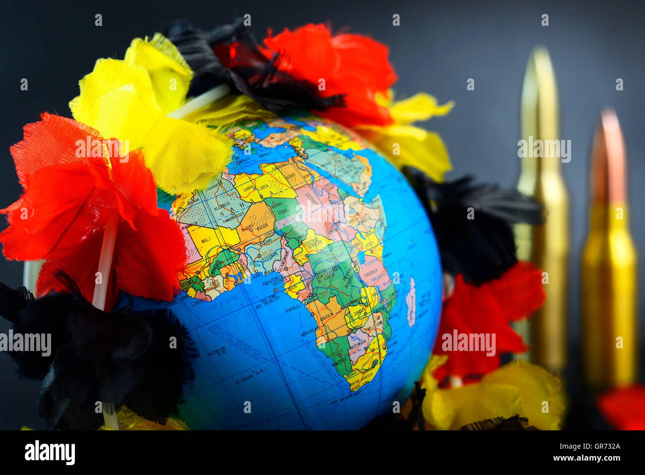Globe With German Lei, Flow Of Refugees - Stock Image