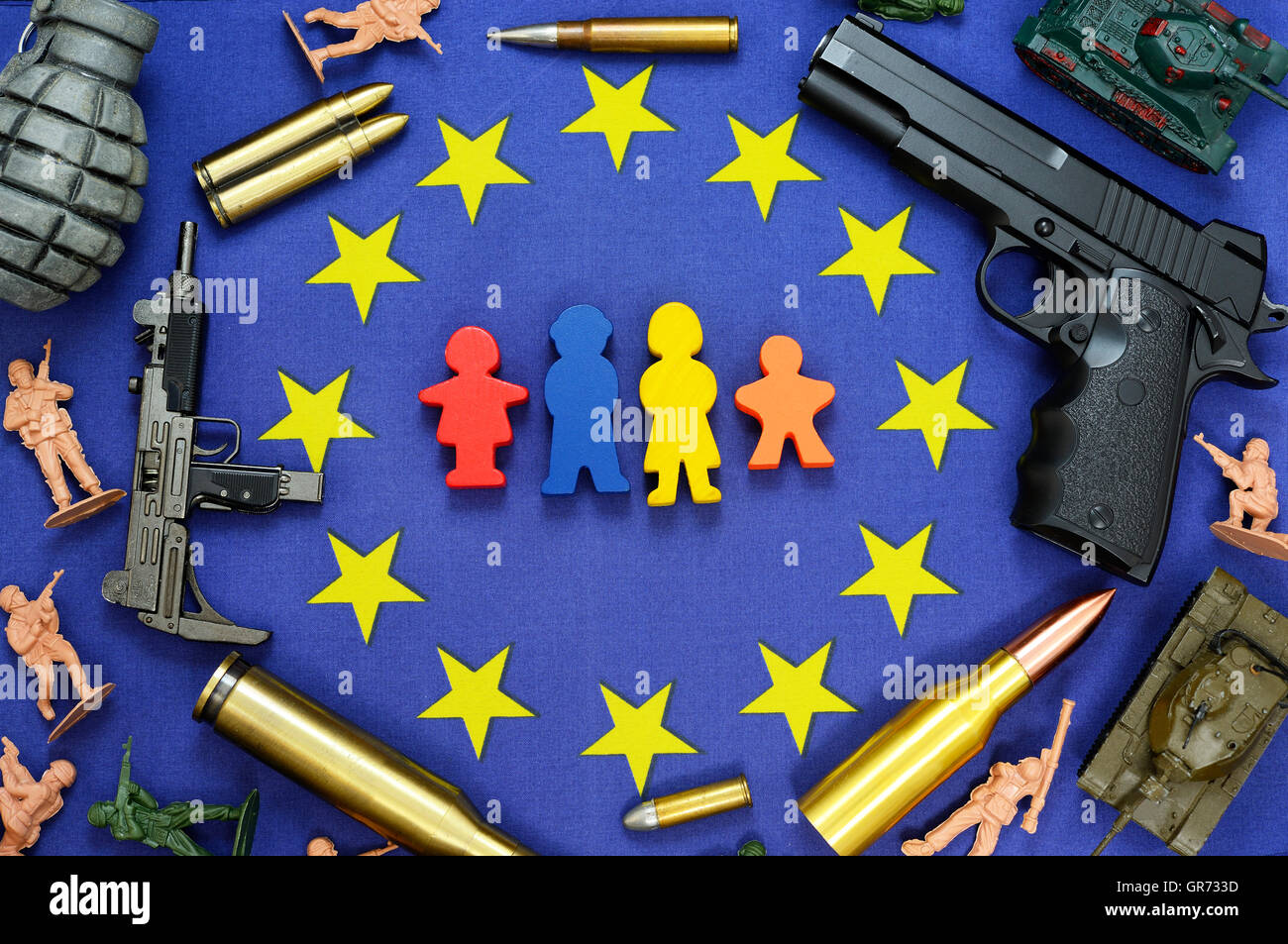 Eu Flag, Weapons And Miniature Family Figures, Wave Of Refugees - Stock Image