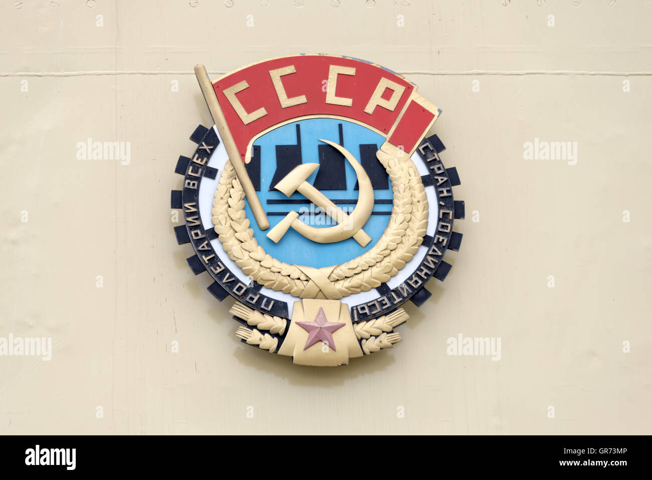 Soviet CCCP emblem with hammer and sickle on a wall - Stock Image