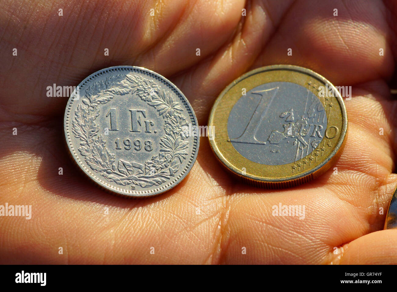 1 Euro And 1 Chf - Stock Image