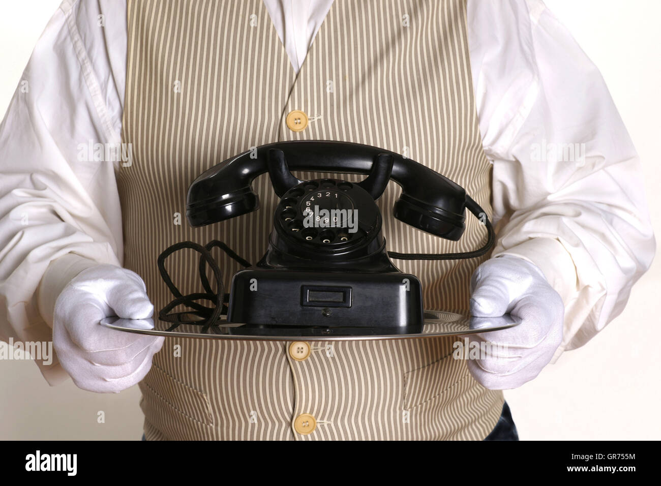 Butler With A Old Telephon - Stock Image