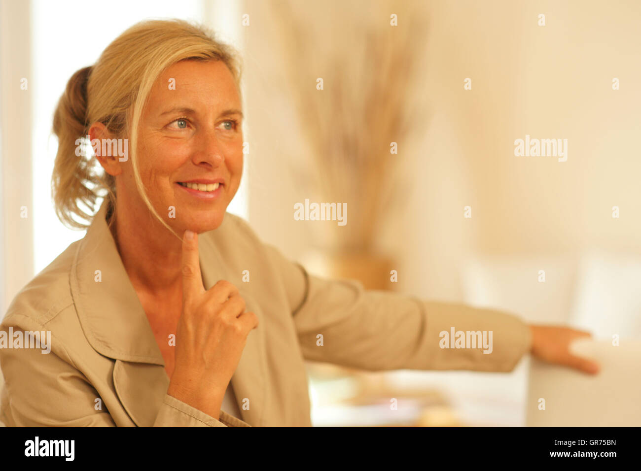 Woman In A Livingroom - Stock Image