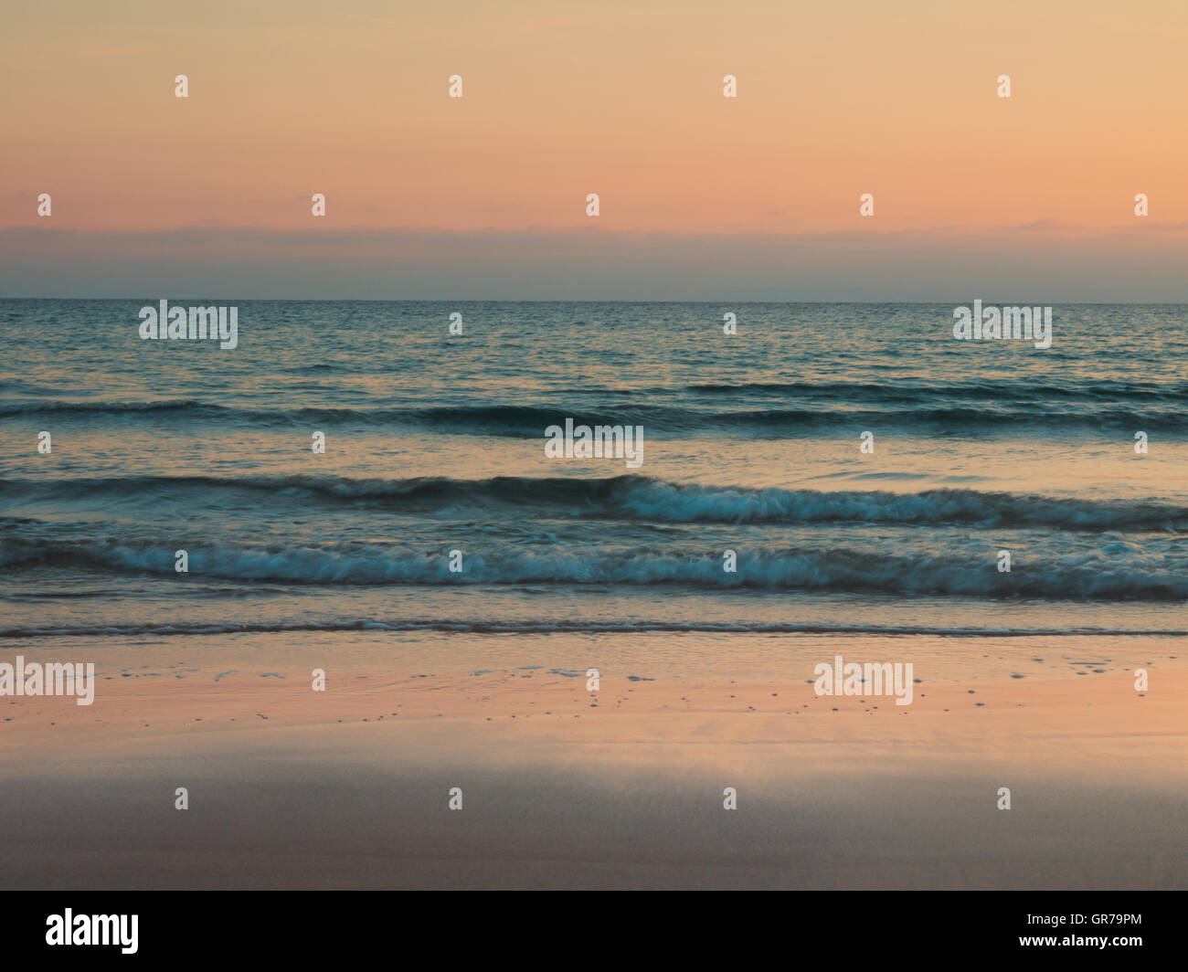 Tranquil Beach Scene Retro Styled, Sunset, Sunrise - Stock Image