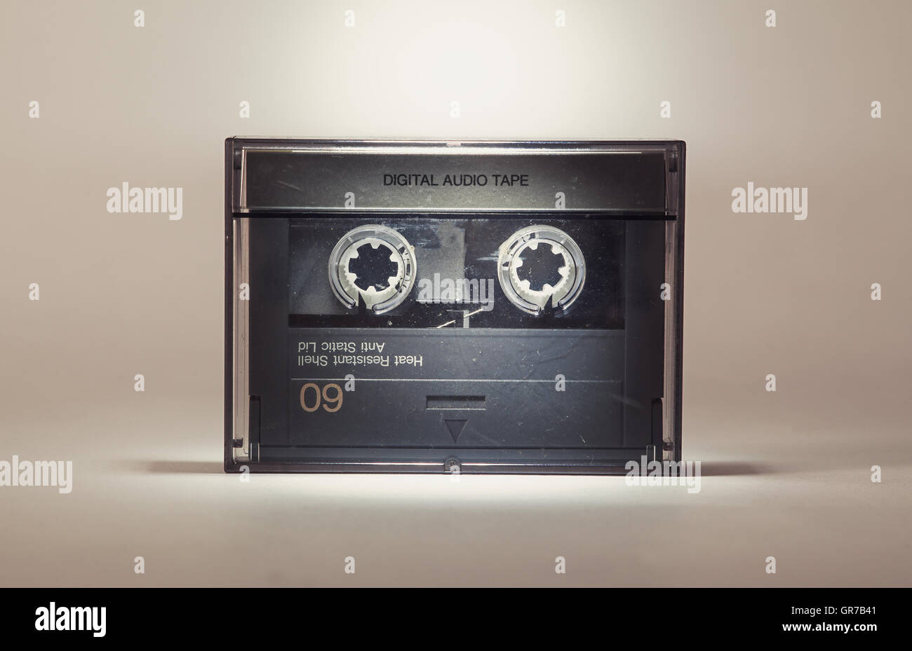 Details of an old dusty digital audio tape, retro technology from the 90's. - Stock Image