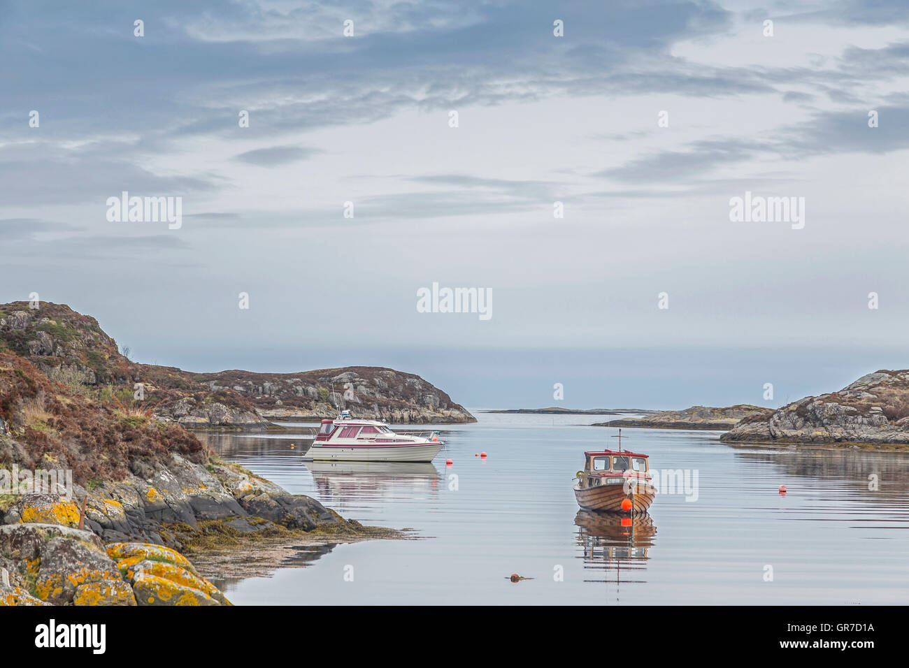 Fishing Boat Anchored On The Sheltered Harbor Entrance - Stock Image