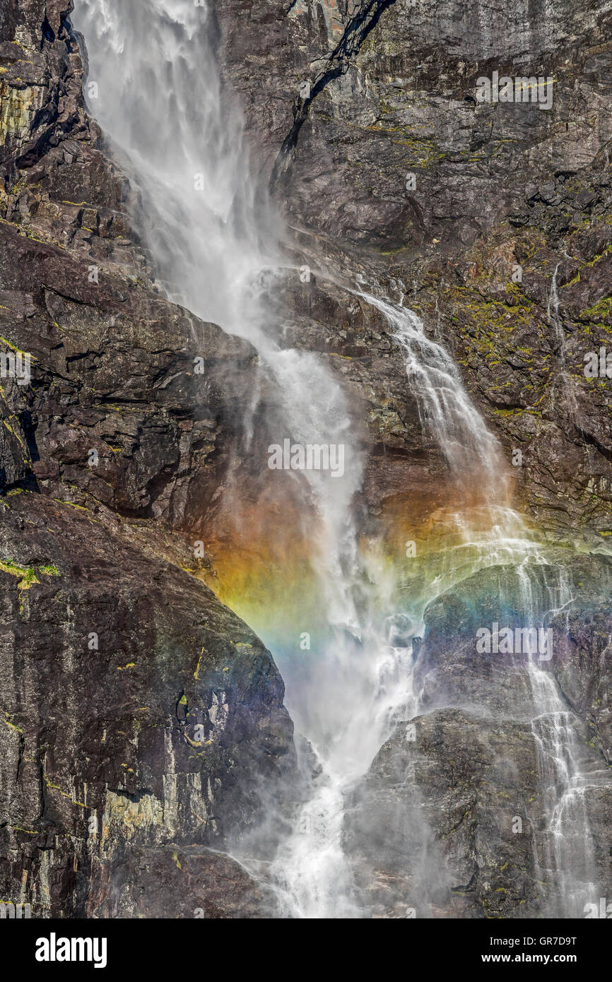 Always Fascinating Rainbow Effect On A Norwegian Waterfall In Romsdal - Stock Image
