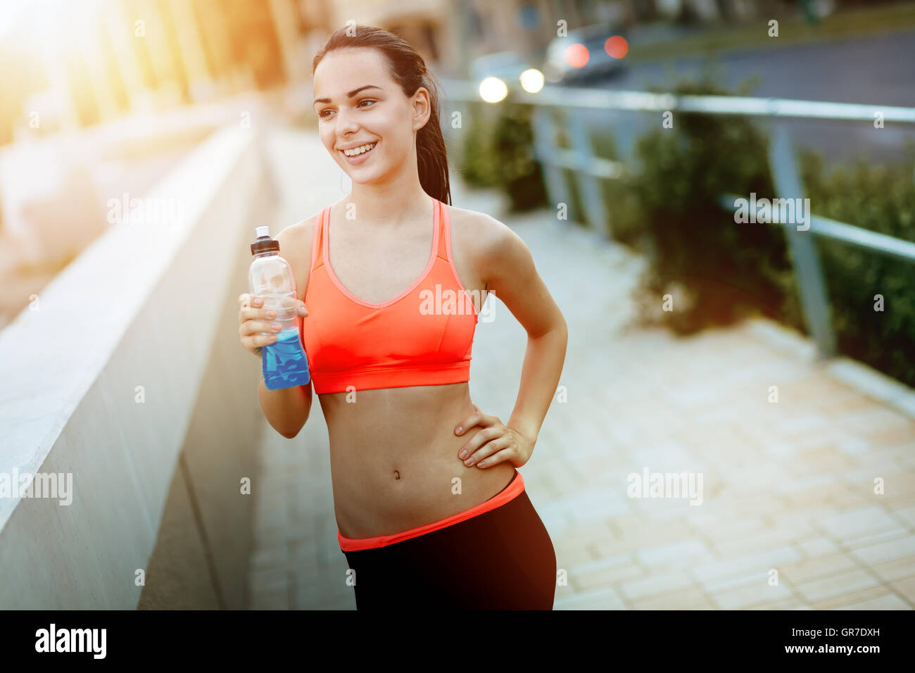 Determined woman jogging to stay healthy - Stock Image
