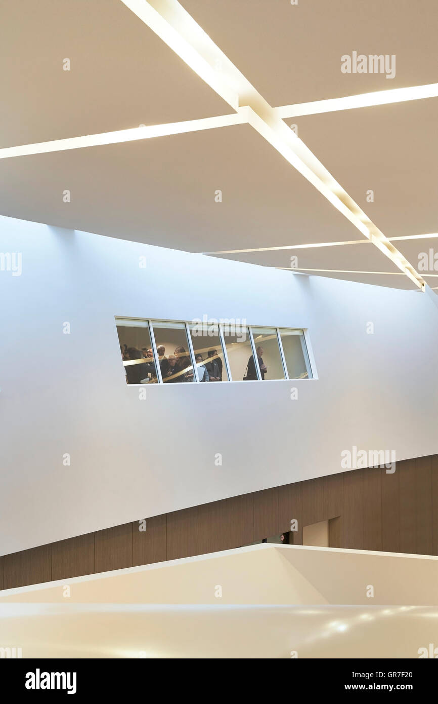Detail of entrance hall with inserted lighting and oblong interior window. Centre du Congres, Mons, Belgium. Architect: - Stock Image
