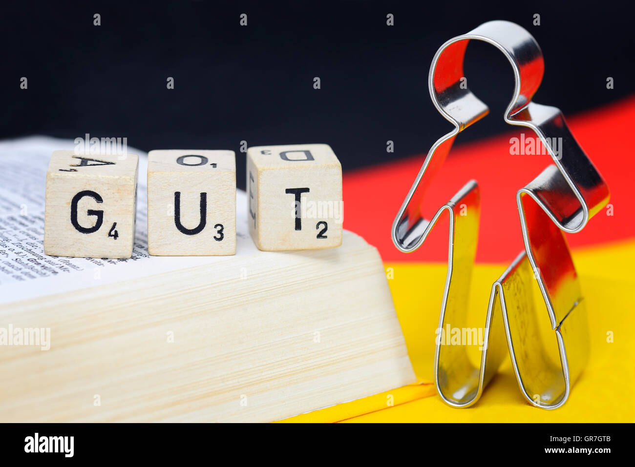 Letter Cubes, Human Figure And Flag Of Germany, Do-Gooder - Stock Image