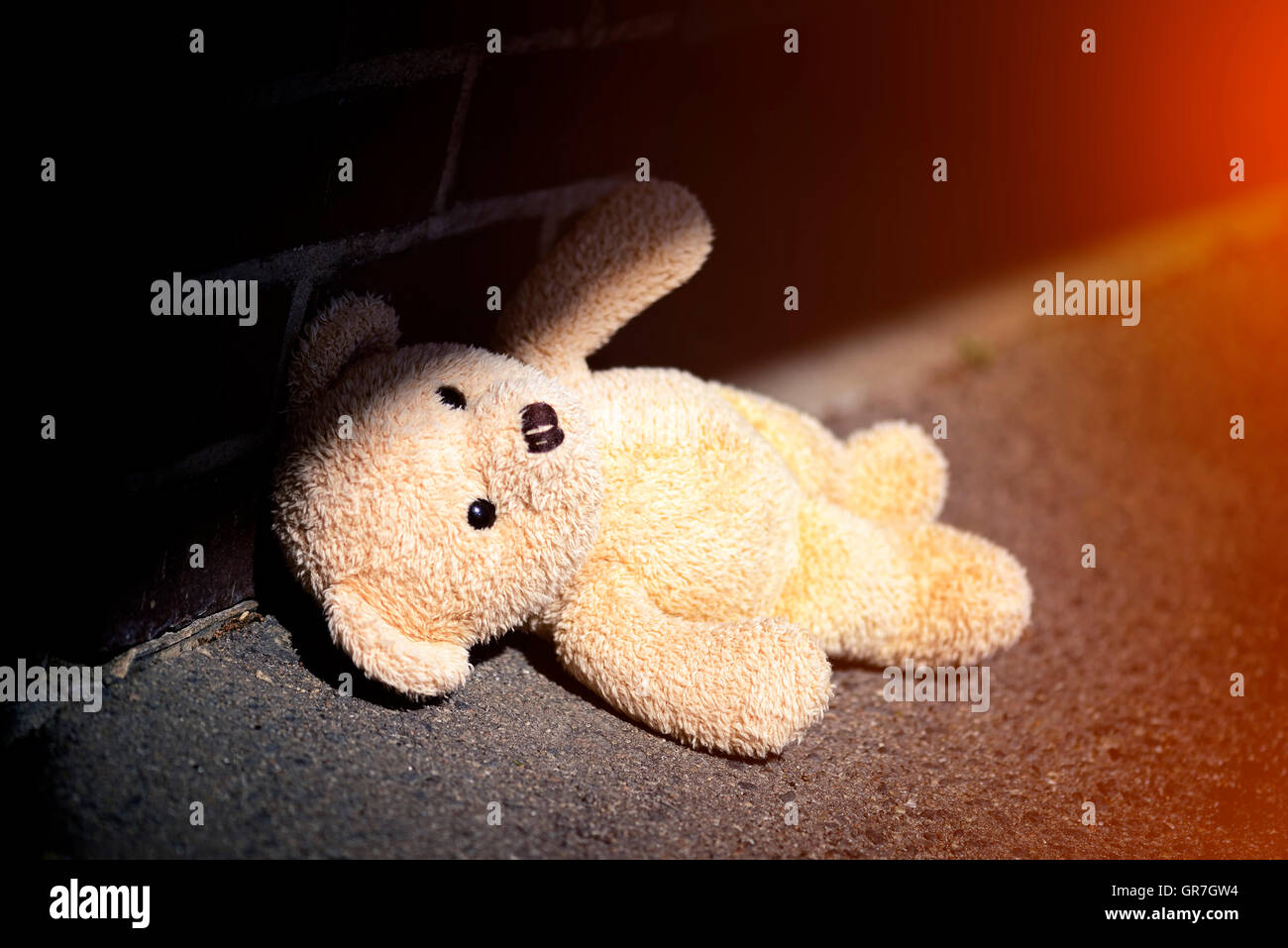 Teddy Bear On The Ground, Childhood Trauma - Stock Image