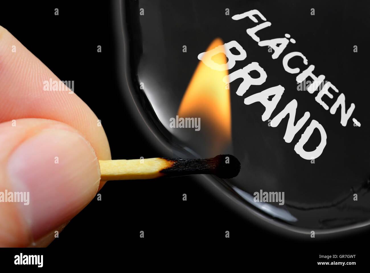 Finger Holding Burning Match, Terror Threats - Stock Image