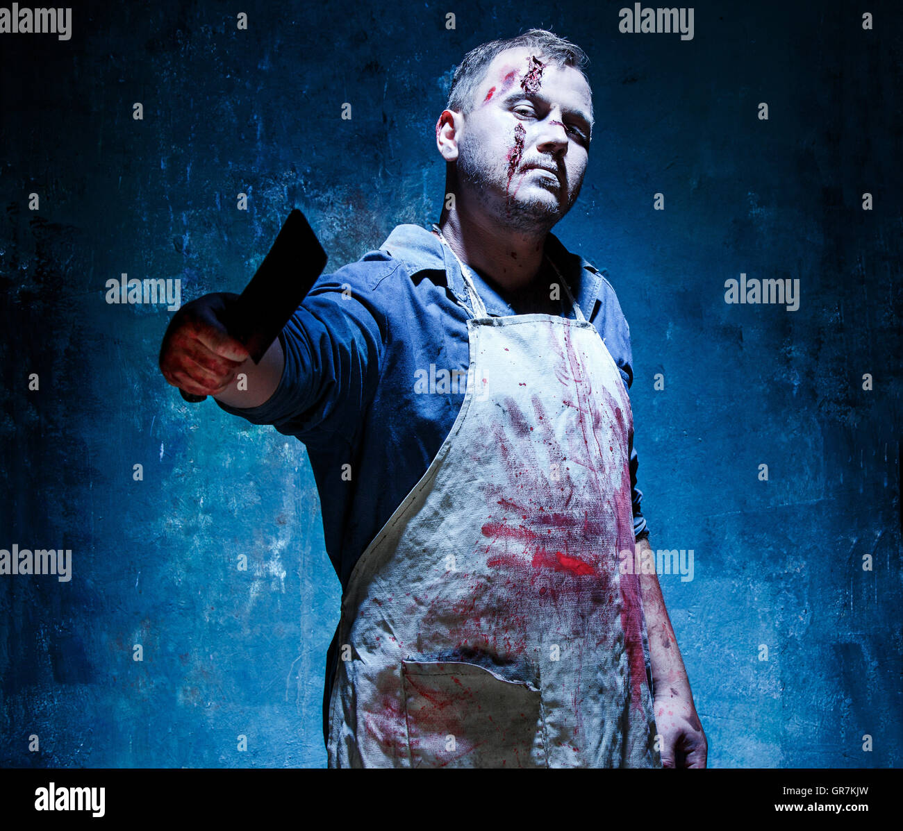 Bloody Halloween theme: crazy killer as butcher with a knife Stock Photo