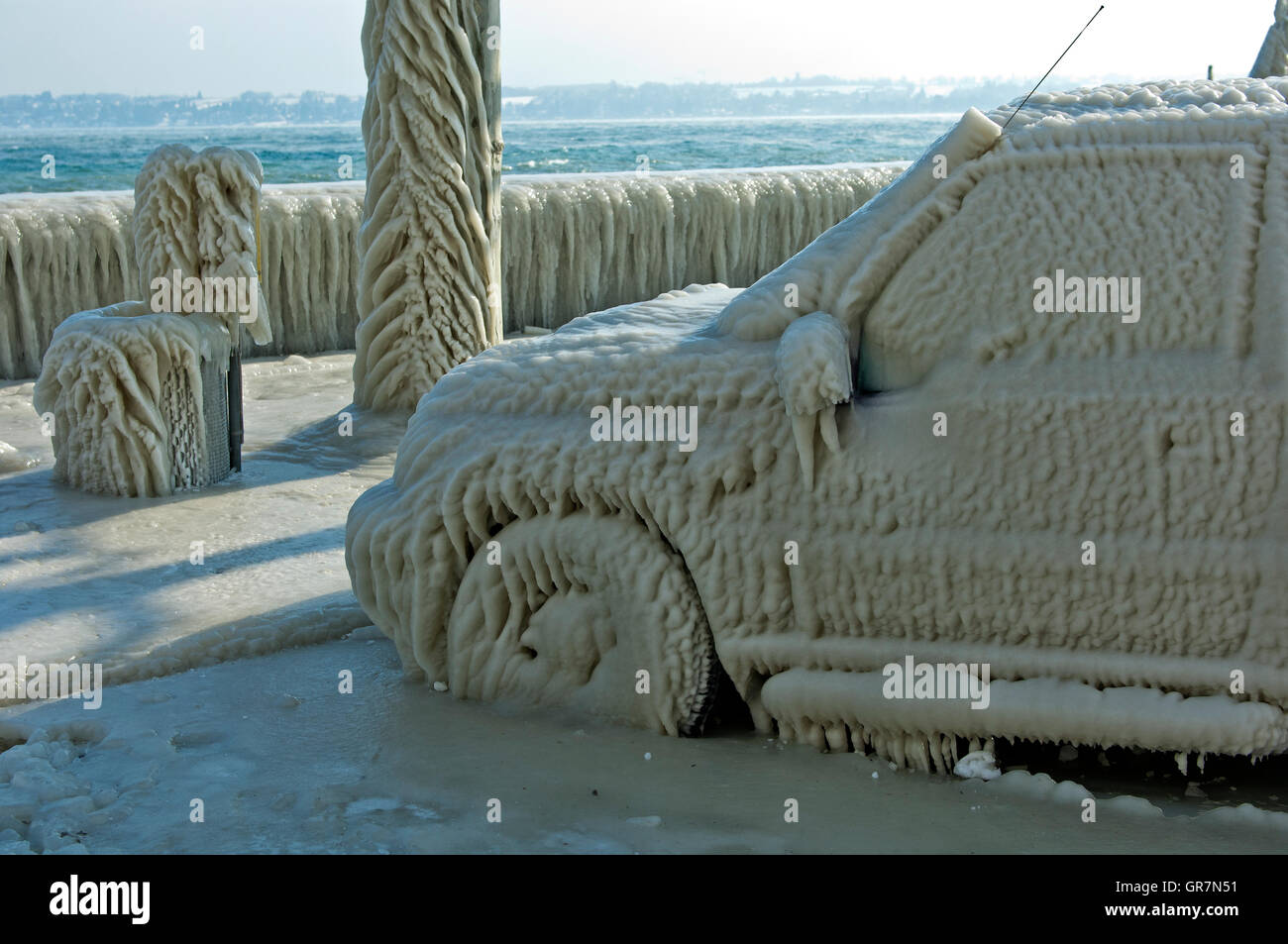Car Covered With A Thick Layer Of Ice Parked In A Street Along Lake Geneva, Versoix, Switzerland - Stock Image