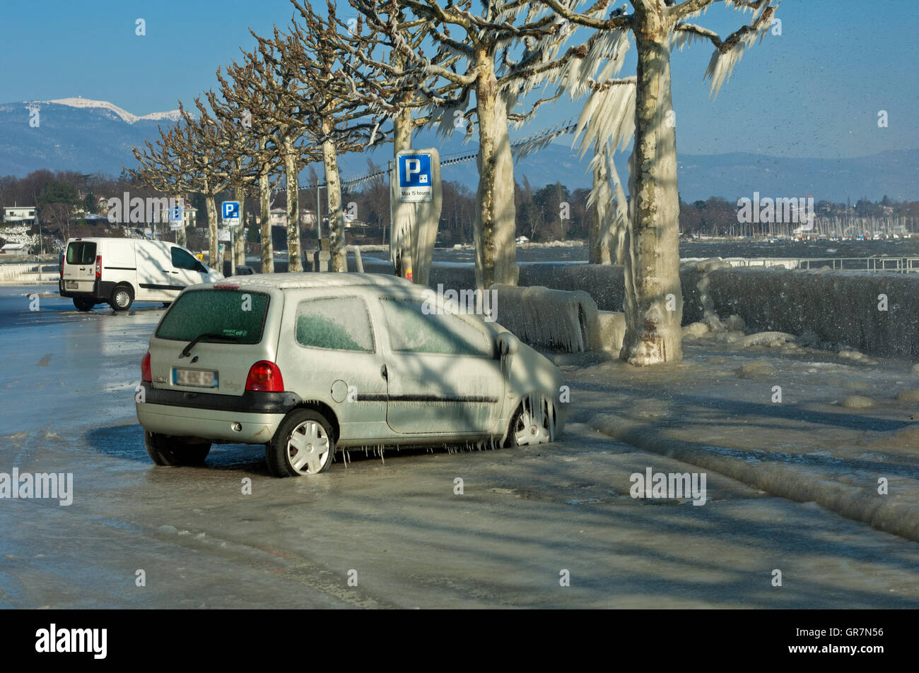 Car Covered With A Thick Layer Of Ice Parked In A Street Along Lake Geneva In Versoix, Switzerland - Stock Image