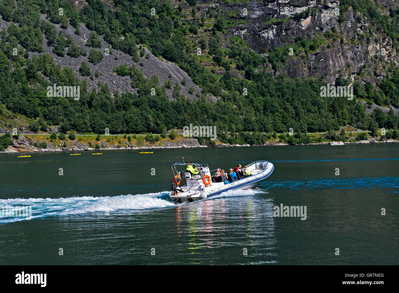 Inflatable Boat With Passengers In The Geiranger Fjord, Geiranger, Norway - Stock Image