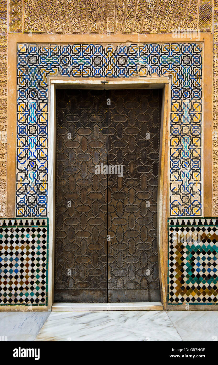 Characteristic Arabic Door And Moorish Arabesques In The Alhambra Fortress, Granada, Andalusia Stock Photo