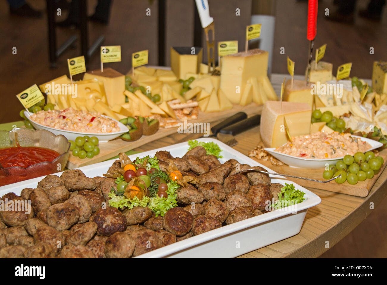 Buffet Table Loaded With Various Culinary Delights - Stock Image