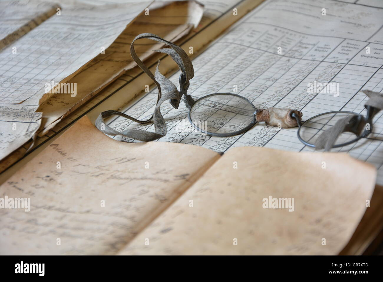 Old, Hand-Written Book With Monocle - Stock Image