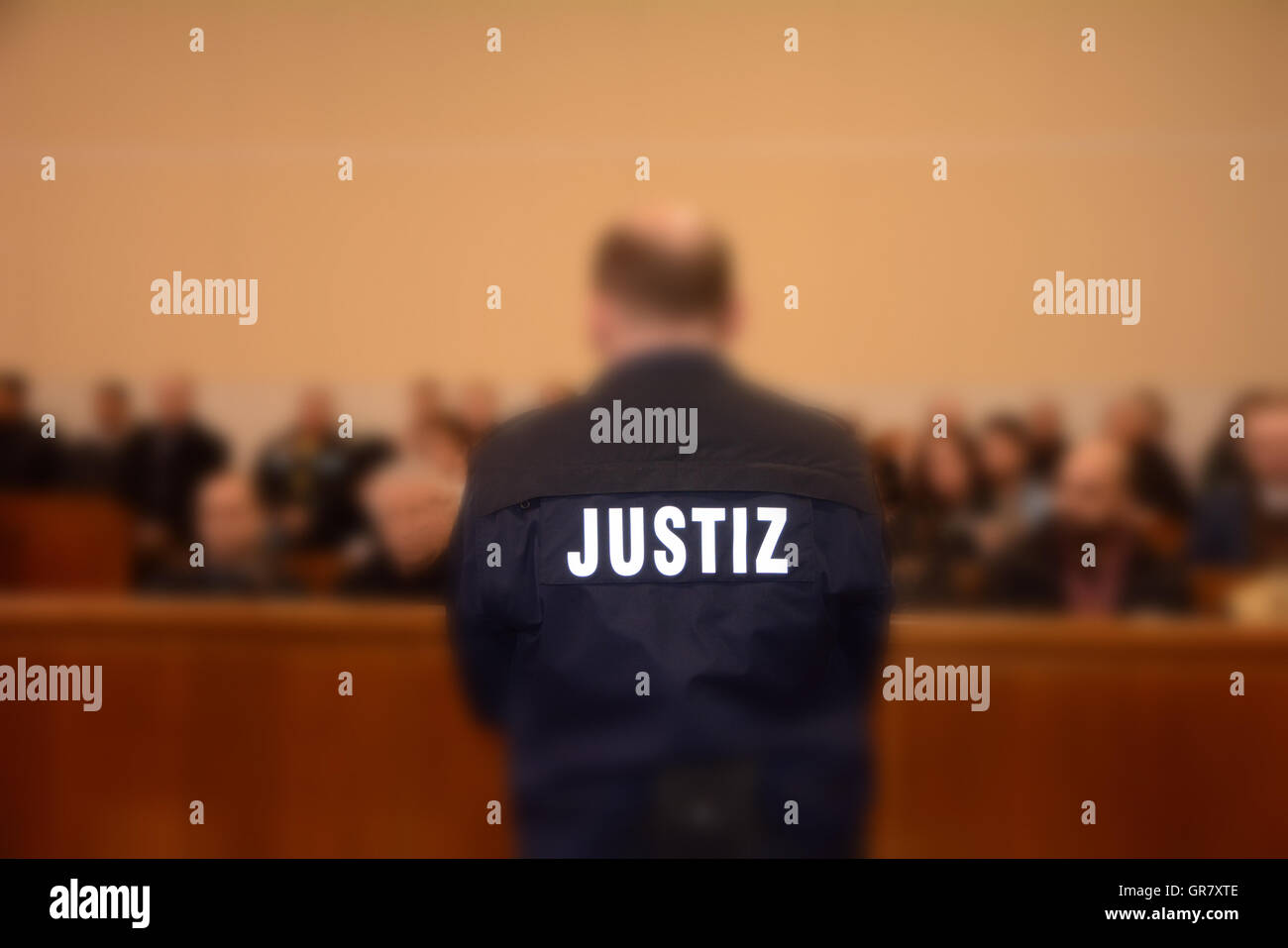 Policeman And Many People In A Courtroom - Stock Image
