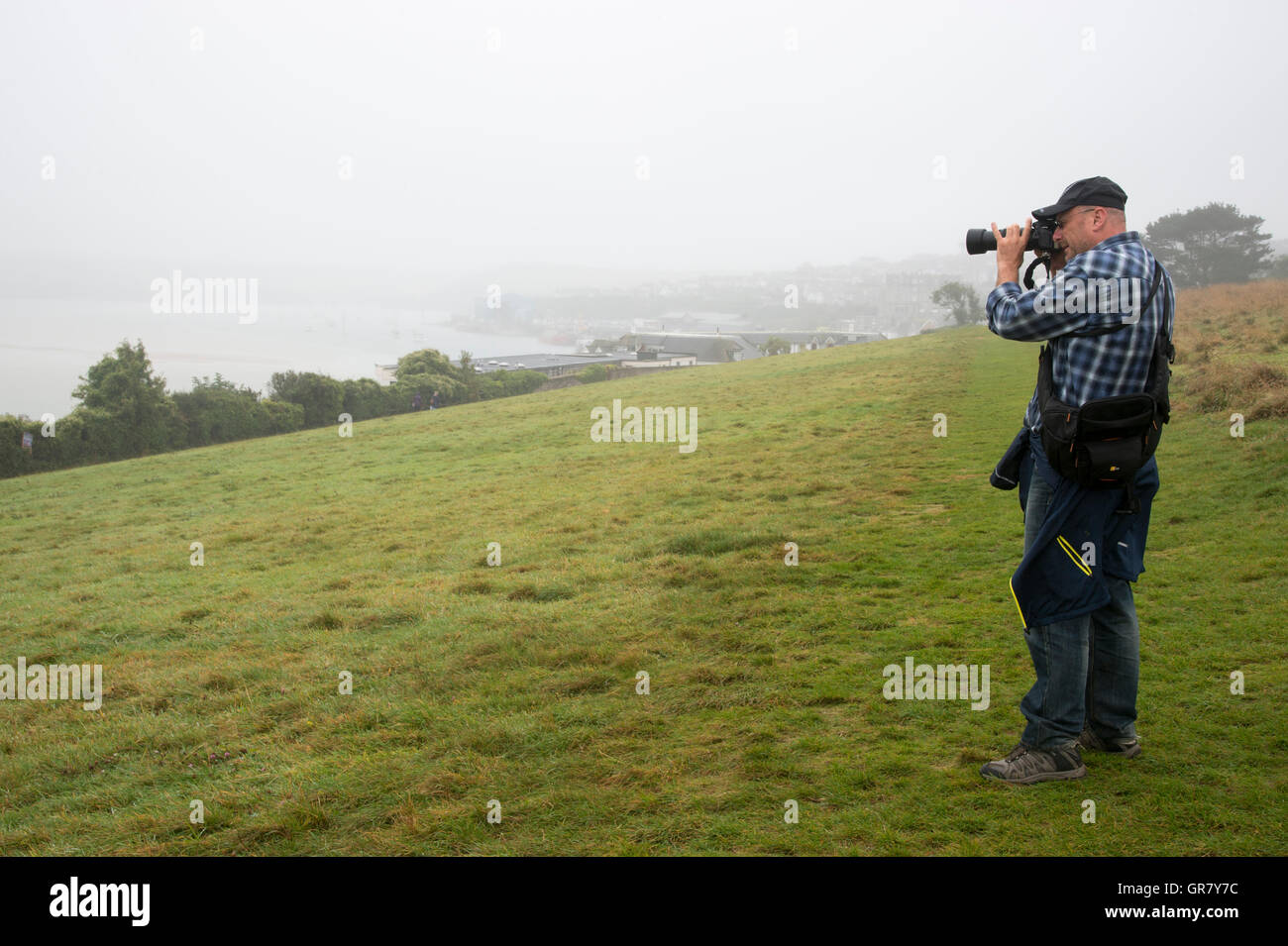One Photographer In The Hills Above The Port Of Padstow - Stock Image