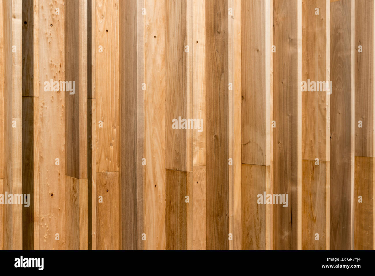 House Wall Made Of Poplar Wood In The Sunshine Stock Photo