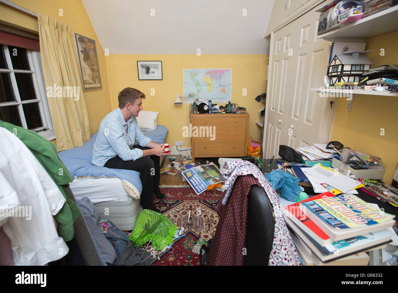 24-year-old University Graduate living back in his boyhood bedroom at parents home due to soaring house prices and - Stock Image
