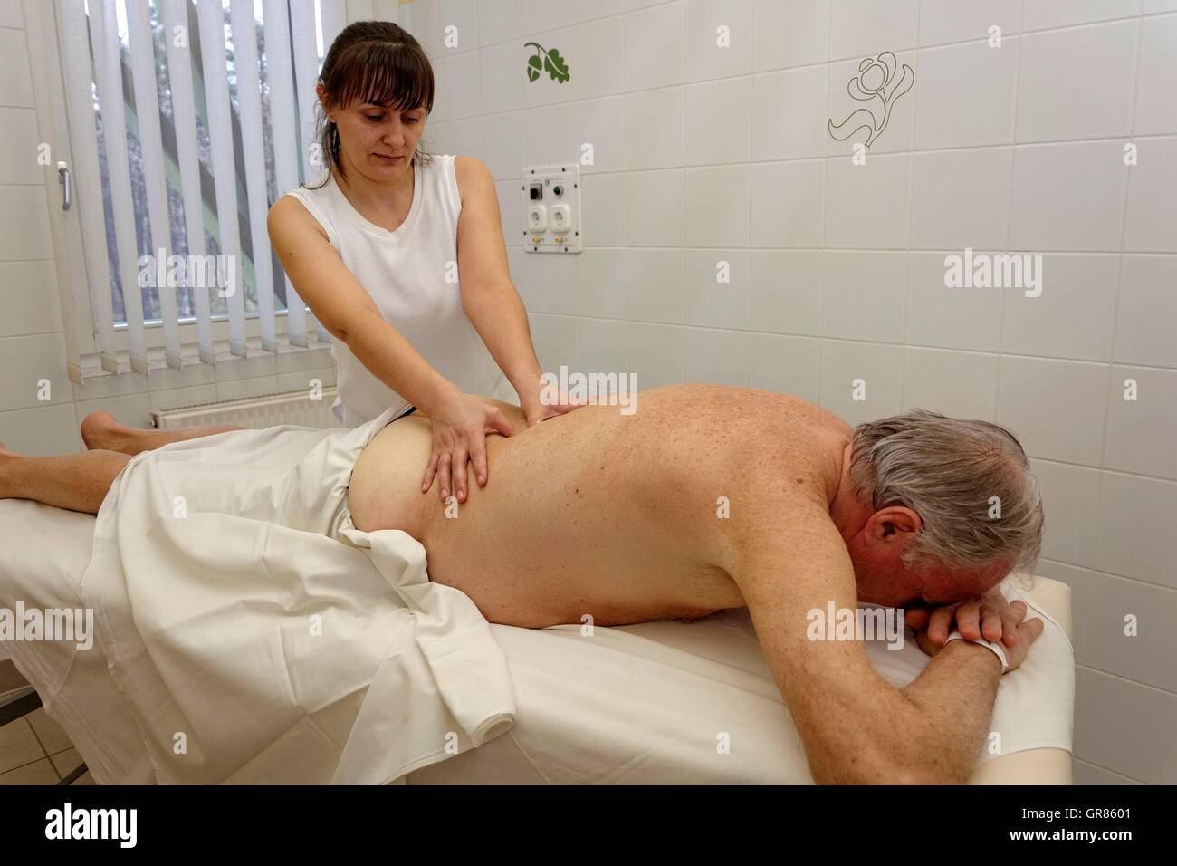 Partial Body Back Massage At Senior By Therapist , Masseuse At The Spa Cegled - Stock Image