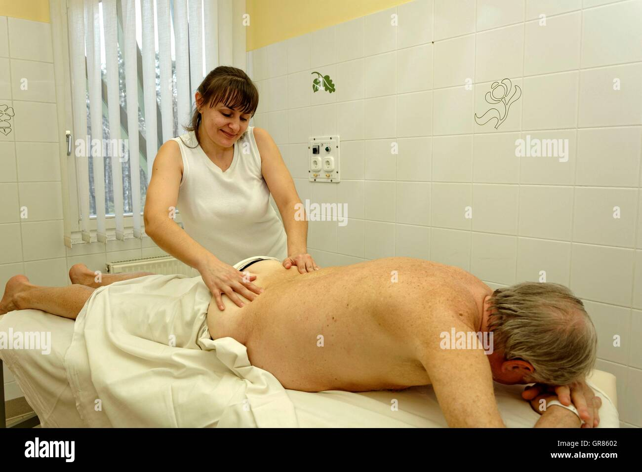 Classic Partial Body Massage By Masseuse At Senior Back In The Spa Cegled - Stock Image