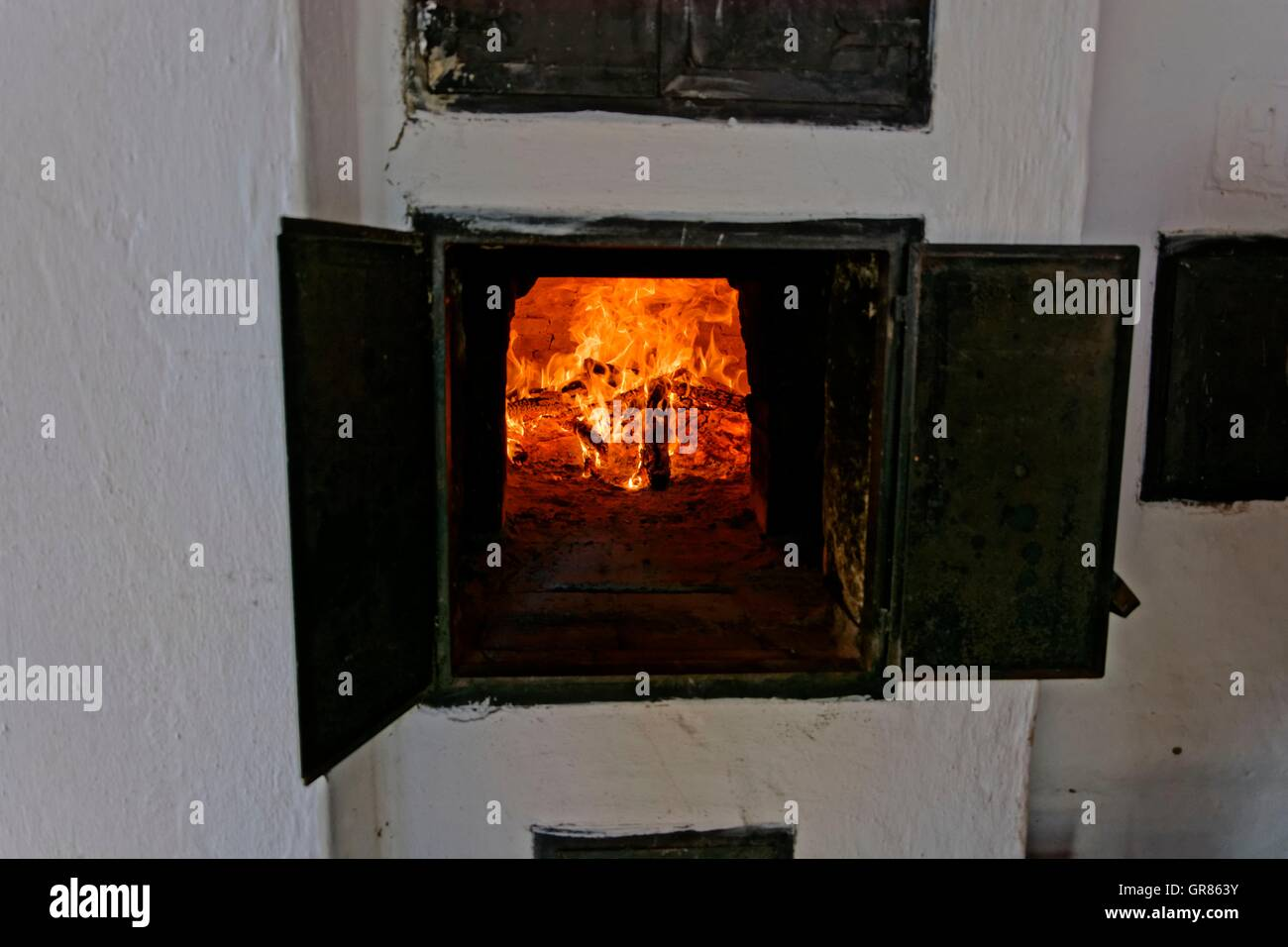 Fire In The Stone Oven With Open Iron Doors Stock Photo