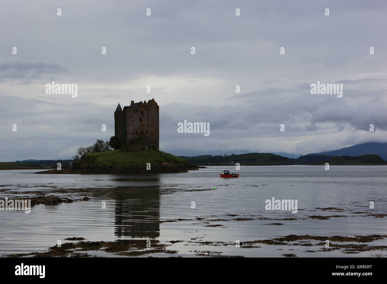 Scotland, Stalker Castle, the depression castle stands on a small, rocky tidal island in the Loch spawn, a bay of - Stock Image