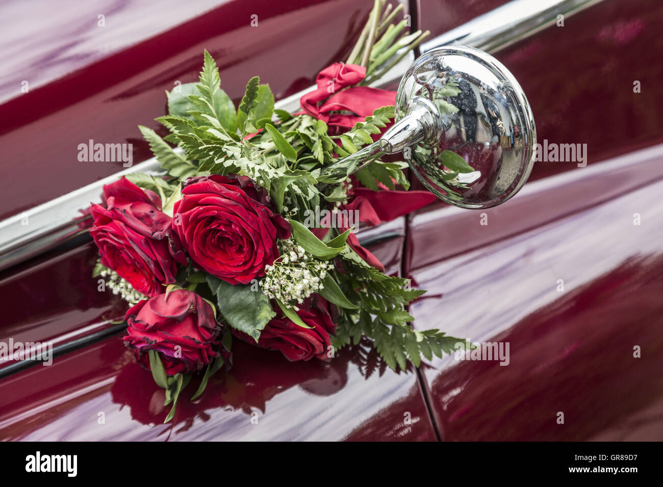 Detail Of A Red Painted Oldtimers, Which Can Be Seen By Its Floral Decoration As A Wedding Car - Stock Image