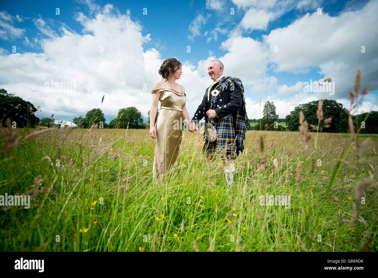 A couple just married in Ireland stand proudly - Stock Image