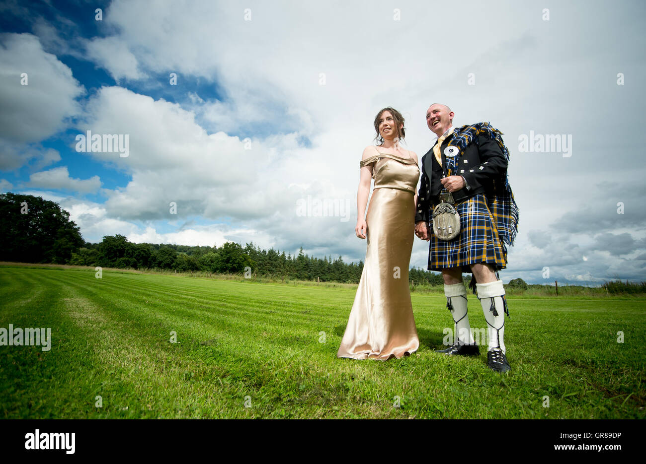 A couple just married in Ireland stand proudly near the hill of Tara - Stock Image