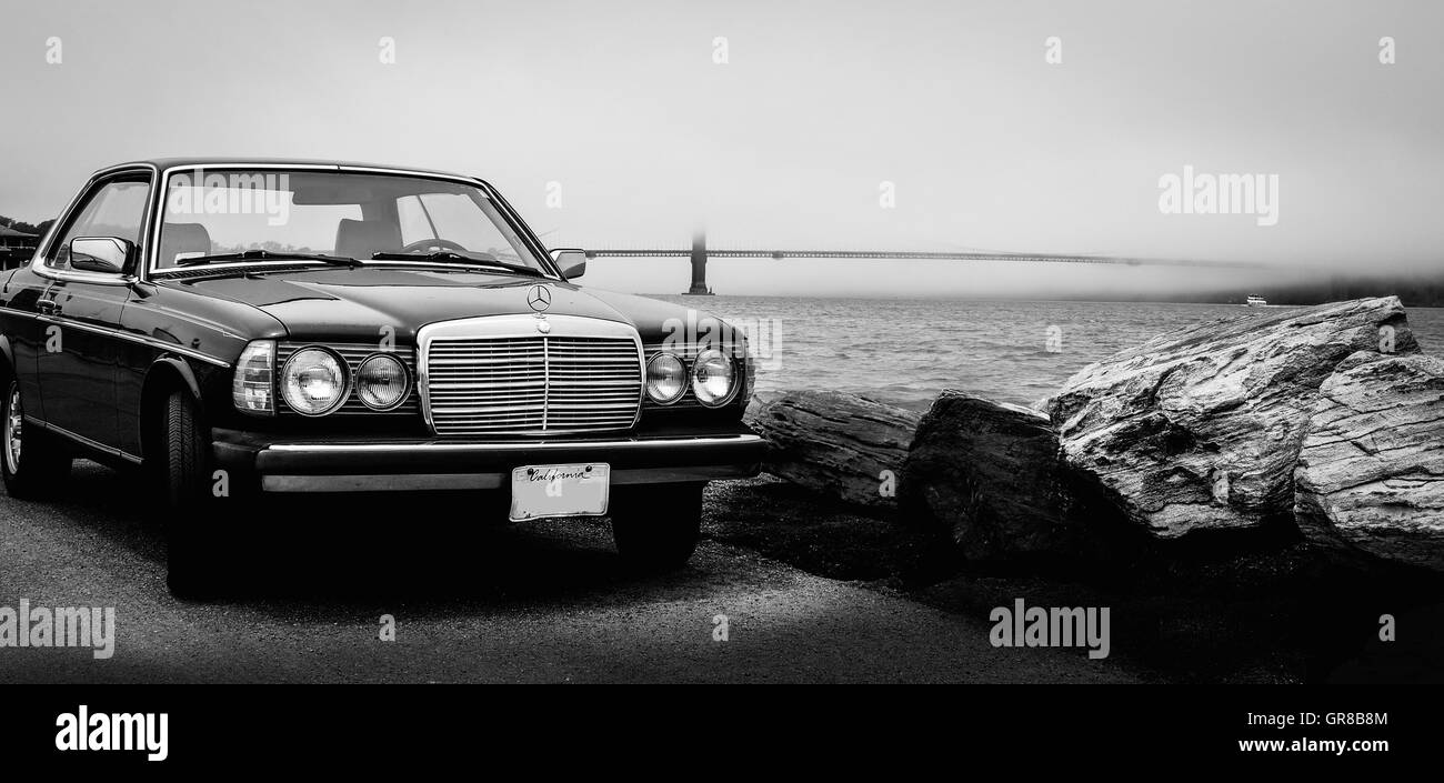 Vintage Car Parked On Street By Seaside - Stock Image