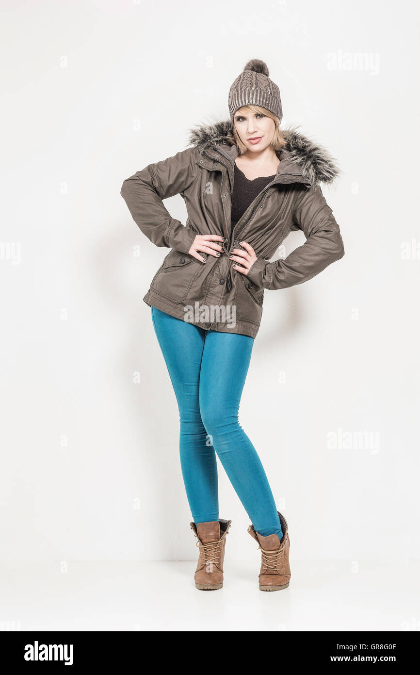 Young Pretty Woman Presents Her Winter Clothes - Stock Image