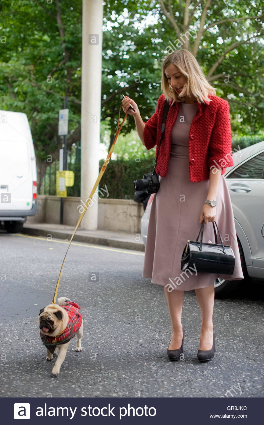 Stephanie with fashion accessory Lenny the dog, outside the Savoy during London Fashion Week FW11. - Stock Image
