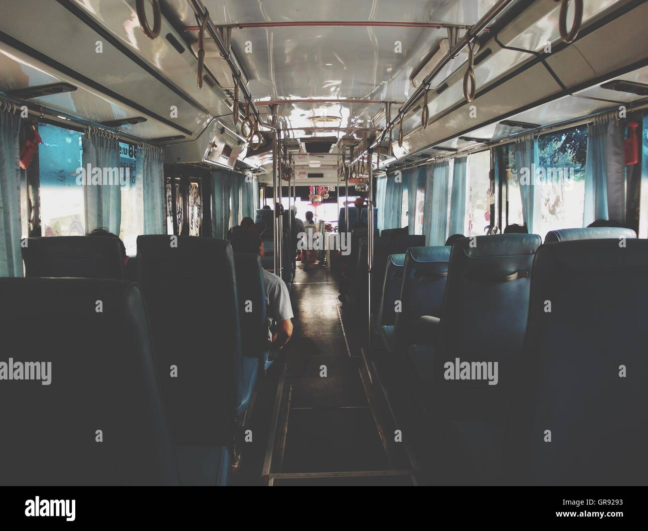 Tour Bus Interior With Incidental People