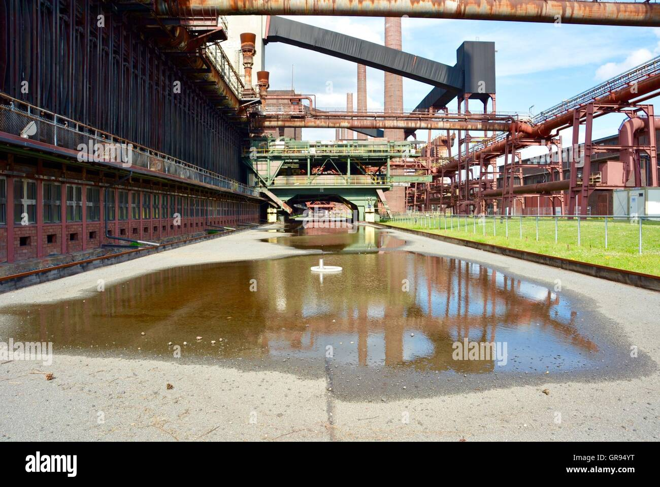 Puddle On Footpath At Zollverein Coal Mine Industrial Complex - Stock Image