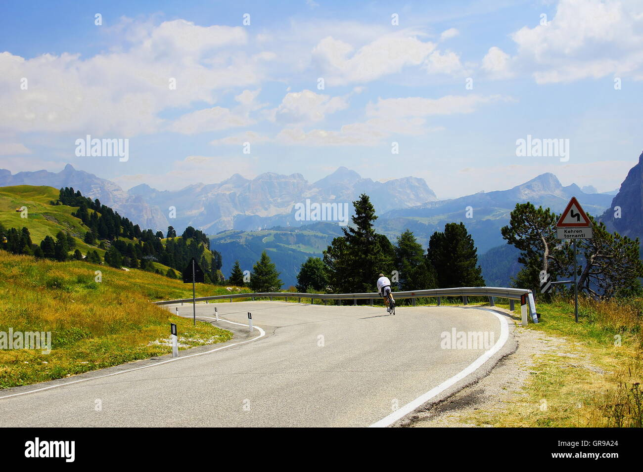 View From Gardena Pass Down Into The Val Badia With The Kreuzkofel Group In The Background Stock Photo