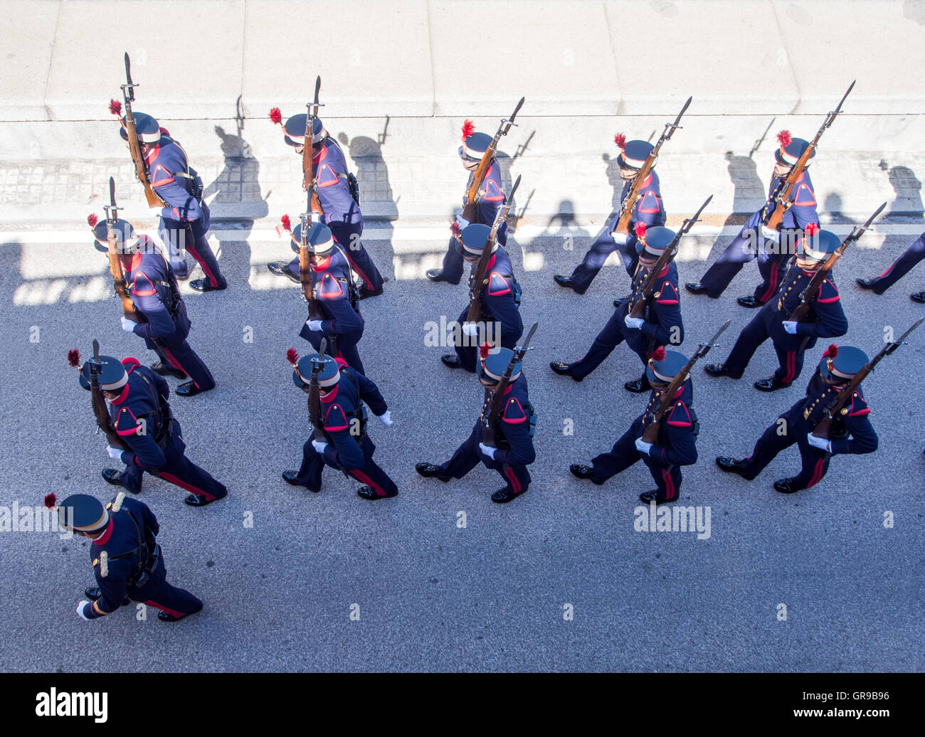 High Angle View Of Army Soldiers Marching On Street - Stock Image