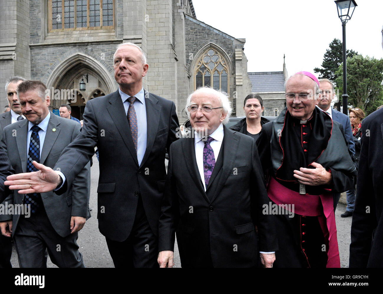 Michael D. Higgins (centre), President of Ireland with Catholic Bishop of Derry The Most Reverend Donal McKeown. - Stock Image