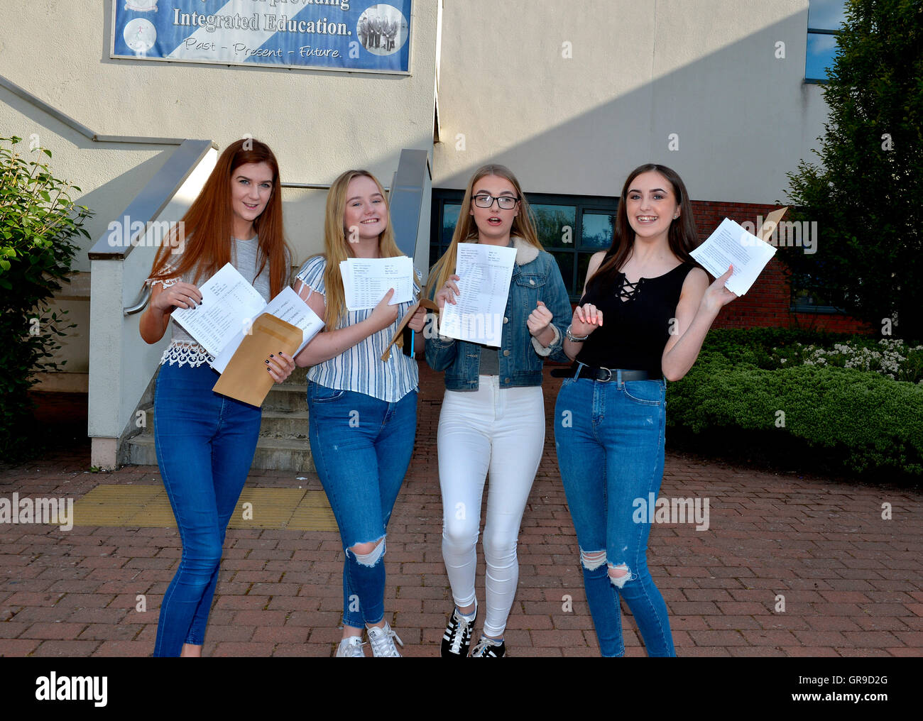 Teenage girls checking GCSE results, Londonderry, Northern Ireland. ©George Sweeney/Alamy - Stock Image