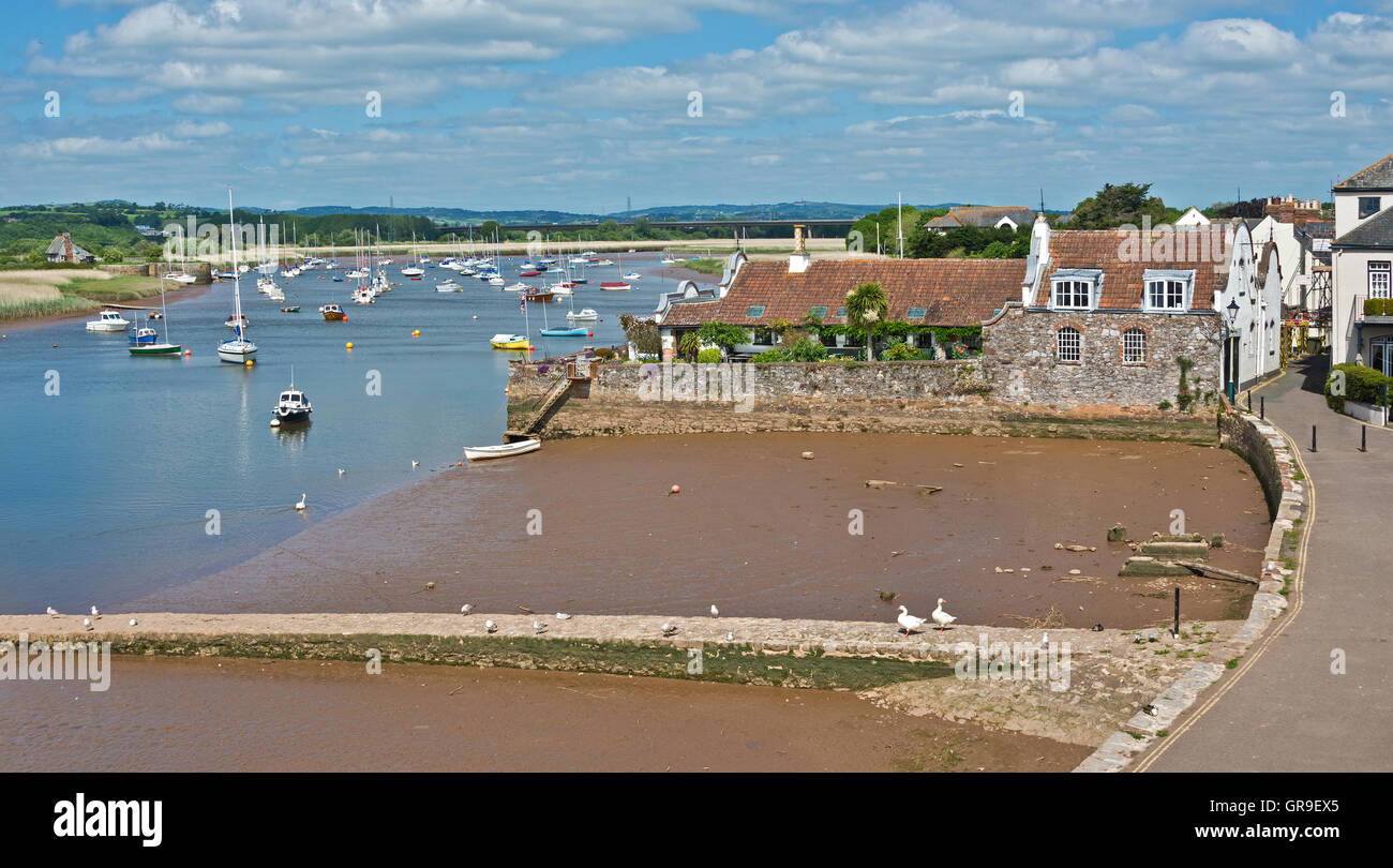 A view along the River Exe towards Exeter from the churchyard at Topsham in Devon with numerous pleasure craft at - Stock Image