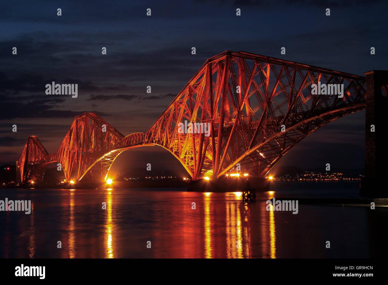 The Forth Bridge illuminated at night, South Queensferry, Lothian, Scotland, UK - Stock Image