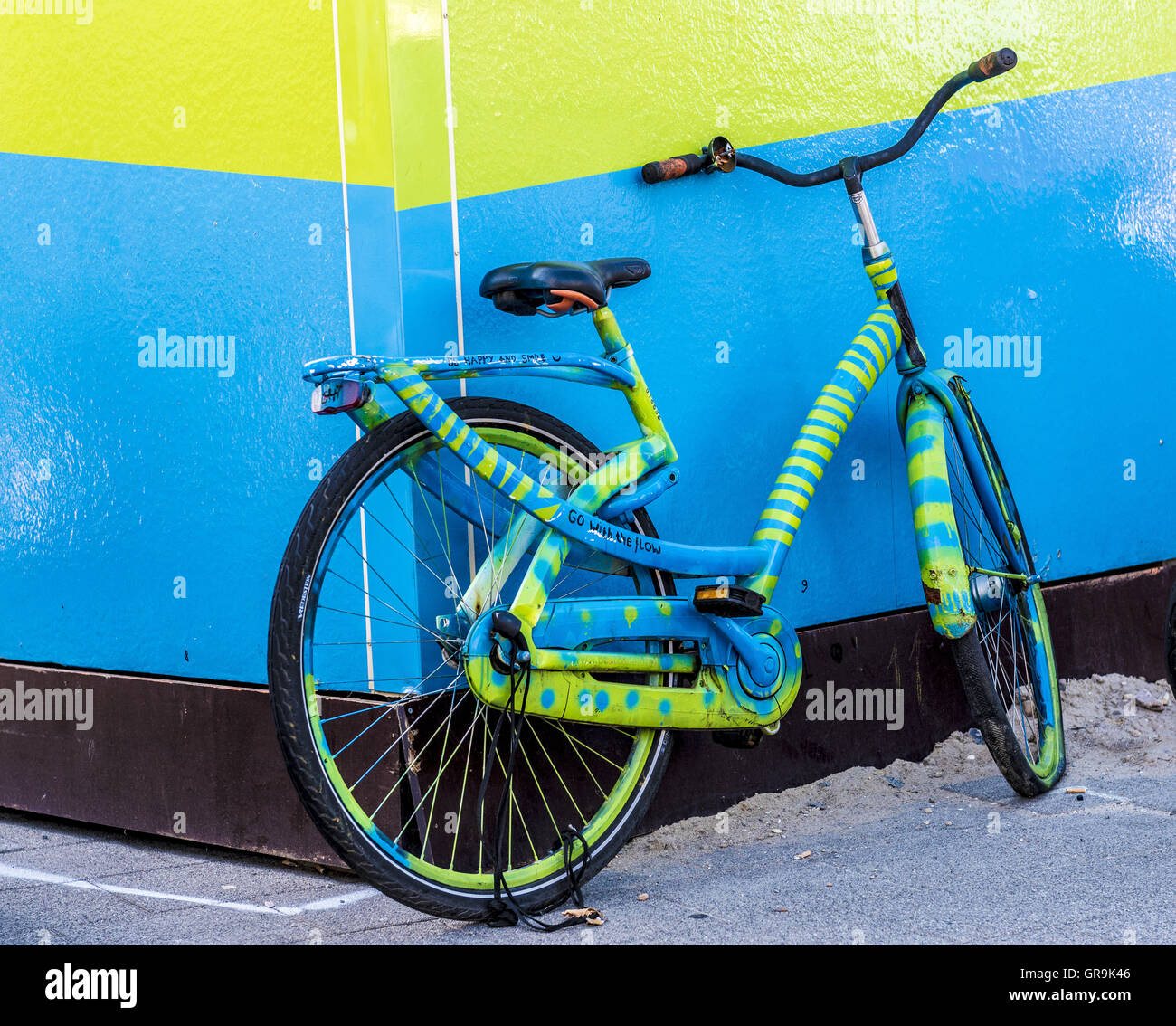 Bluegreen Bycycle Before Bluegreen Wall - Stock Image