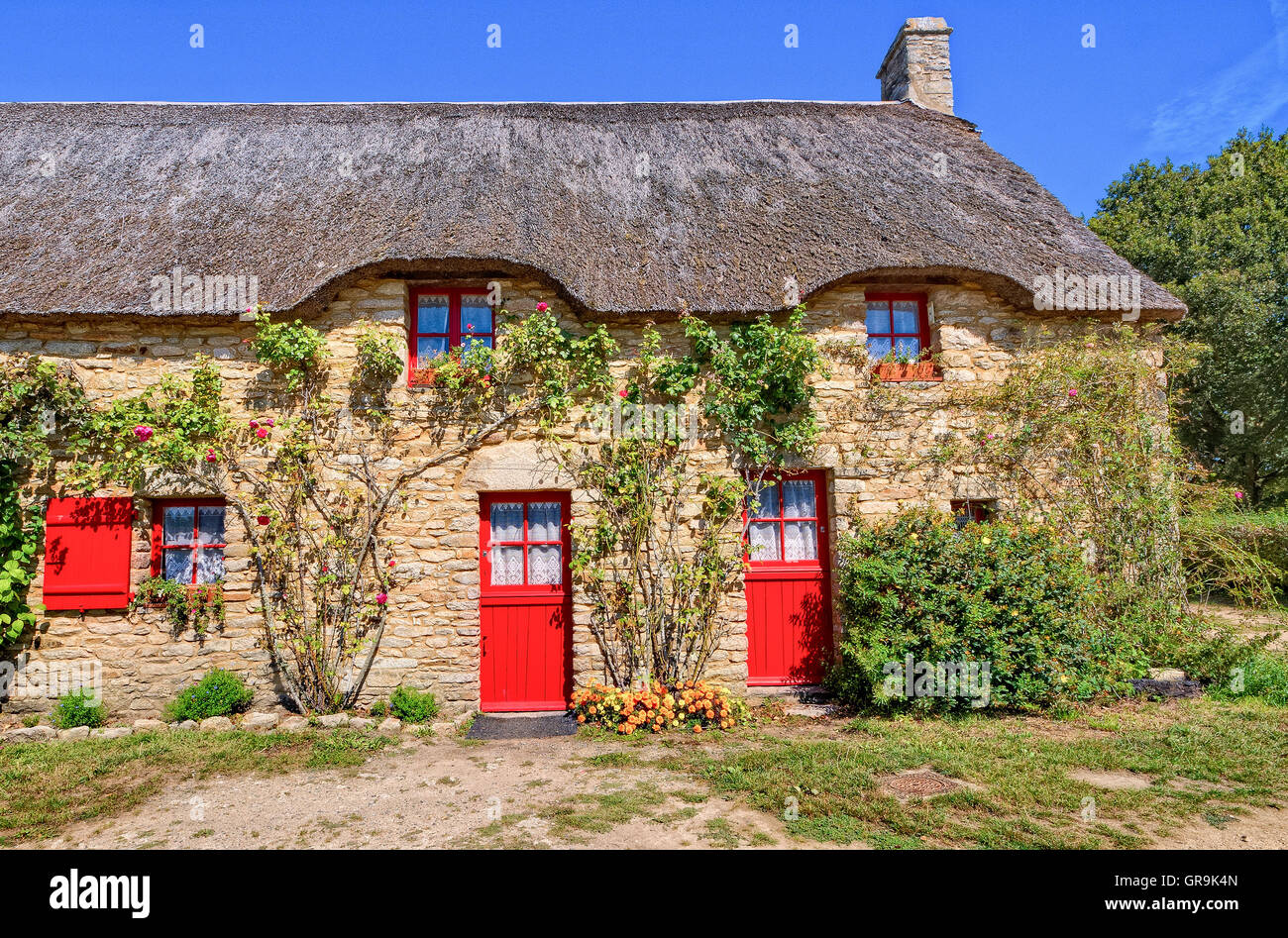 Old Farmhouse With Red Doors, Brittany, France - Stock Image