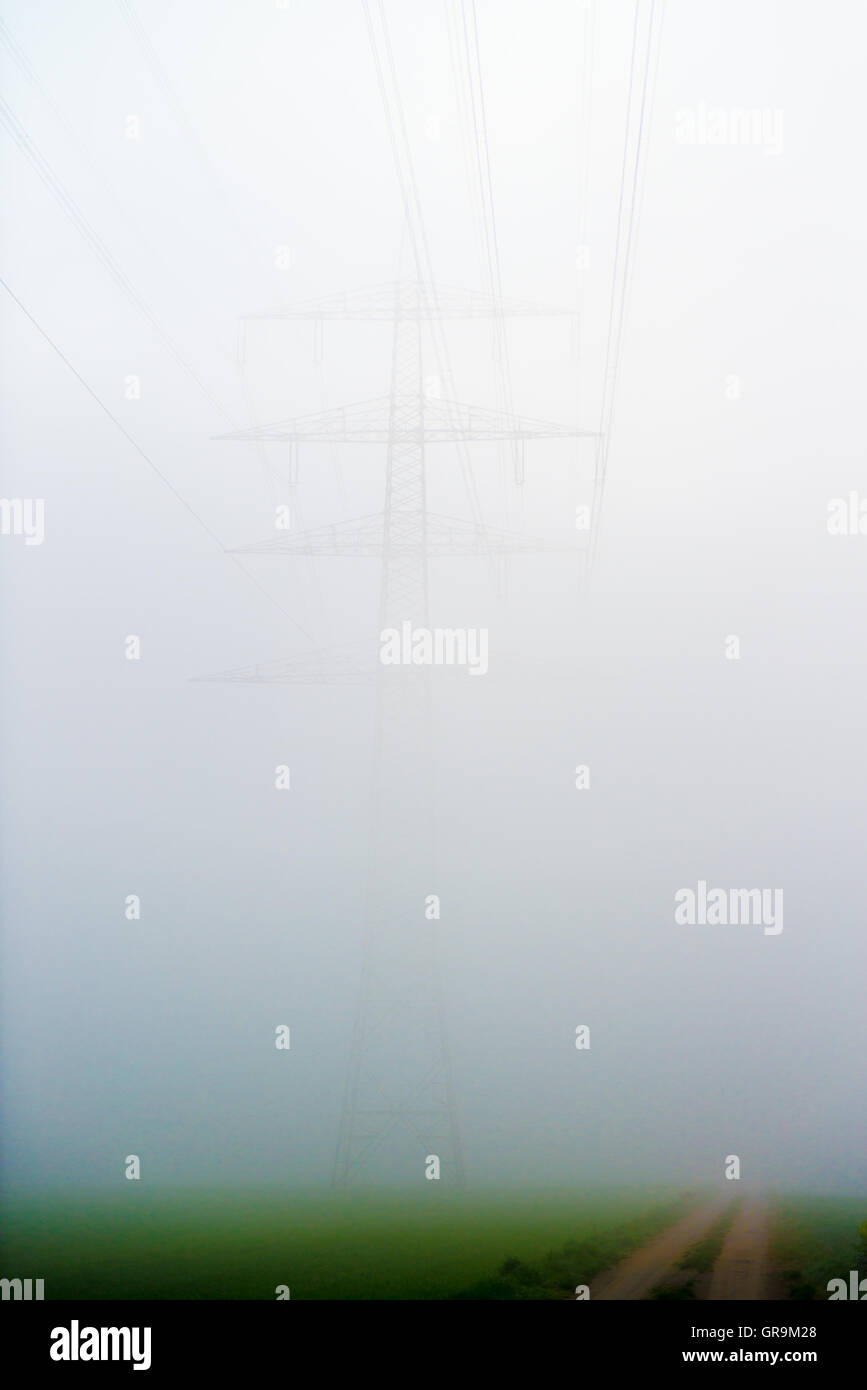 Power Pole Almost From The Fog Concealed - Stock Image