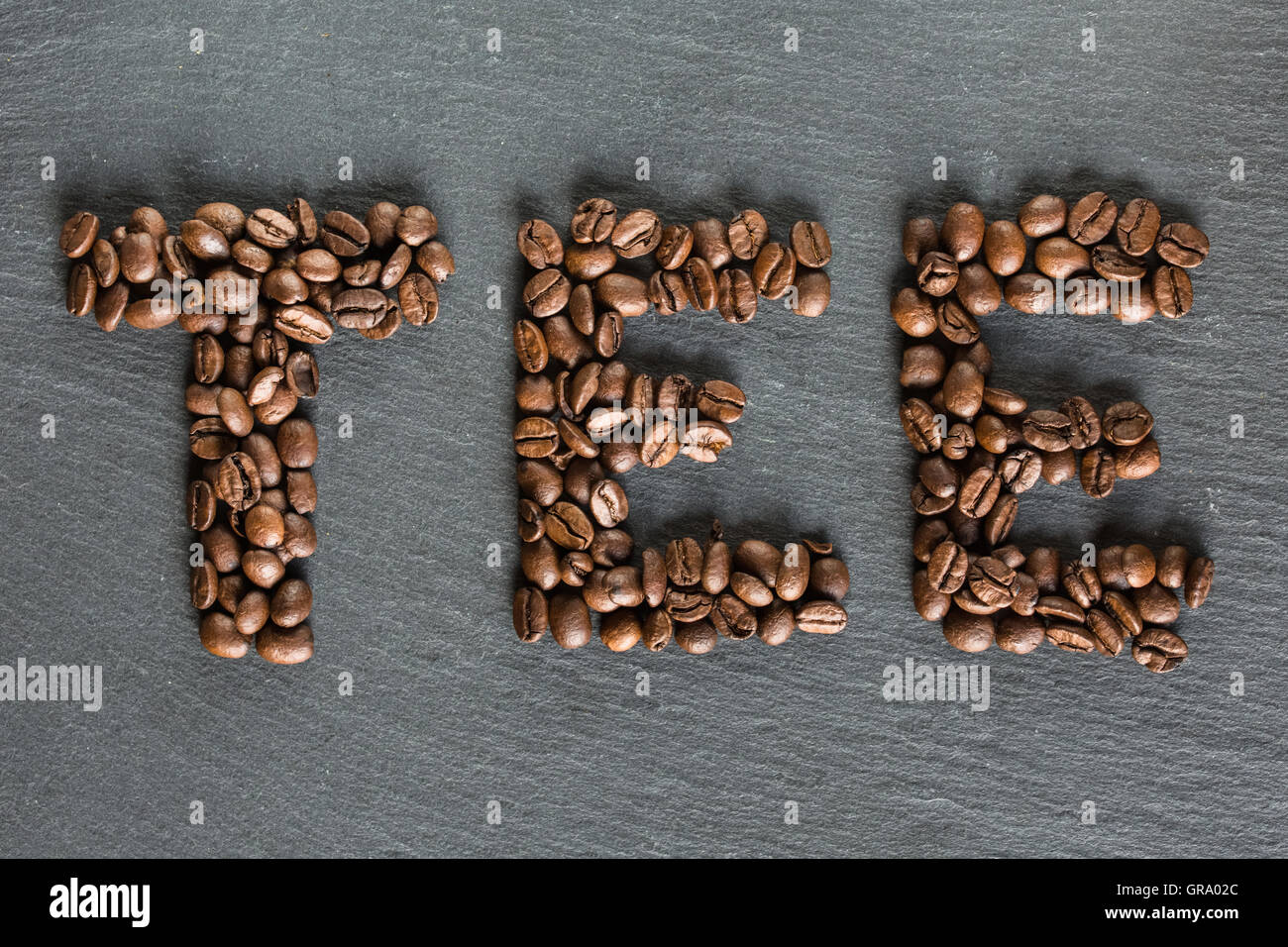 The Word Tea Written From Coffee Beans - Stock Image